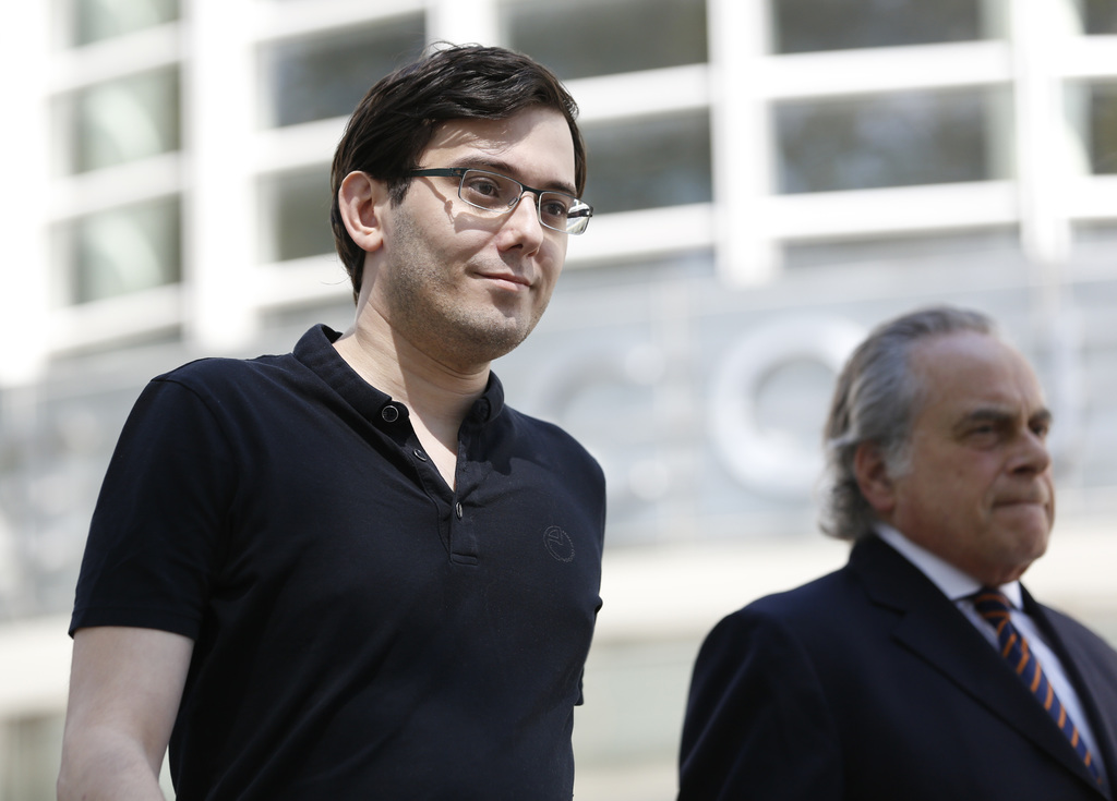 Martin Shkreli, left, and his attorney Benjamin Brafman leave federal court in New York, Friday, Aug. 4, 2017. The former pharmaceutical CEO has been ...