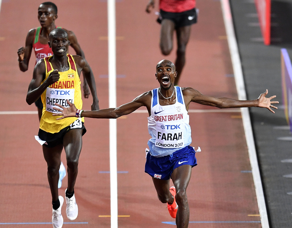 Britain's Mohamed Farah celebrates as he crosses the finish line to win the Men's 10,000 meters final during the World Athletics Championships in Lond...