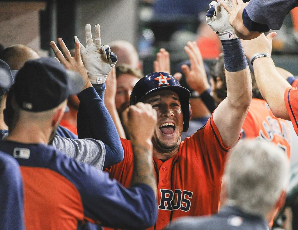 Houston Astros' Alex Bregman, center, celebrates his two-run home run off Toronto Blue Jays relief pitcher Matt Dermody during the fourth inning of a ...