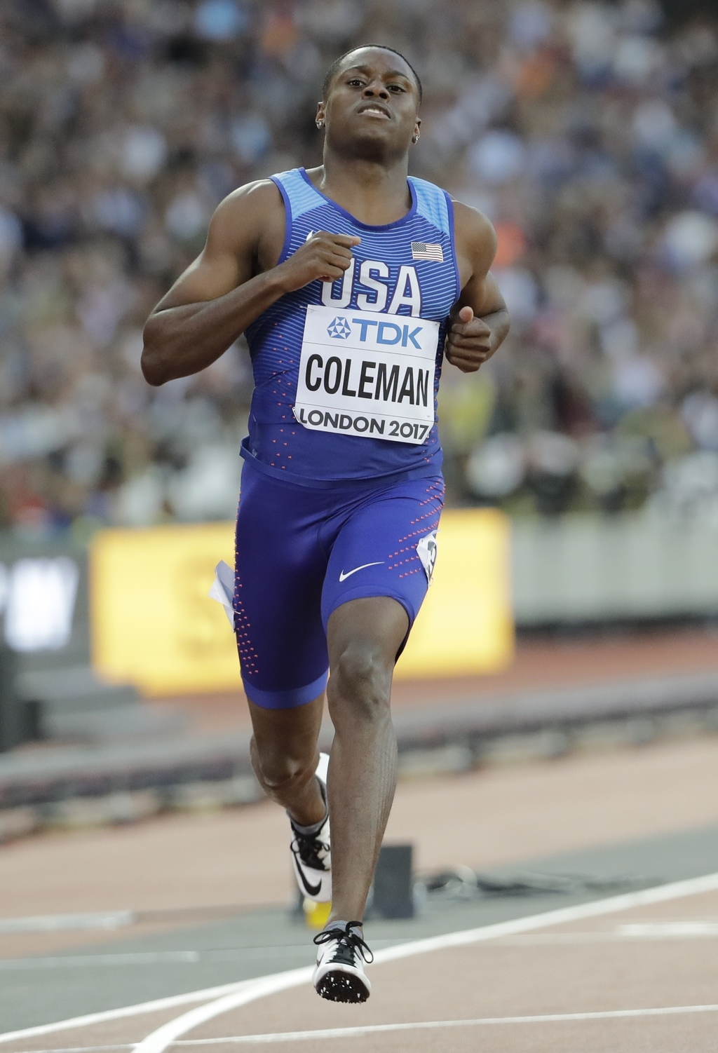 United States' Christian Coleman crosses the line to win a Men's 100m first round heat during the World Athletics Championships in London Friday, Aug....