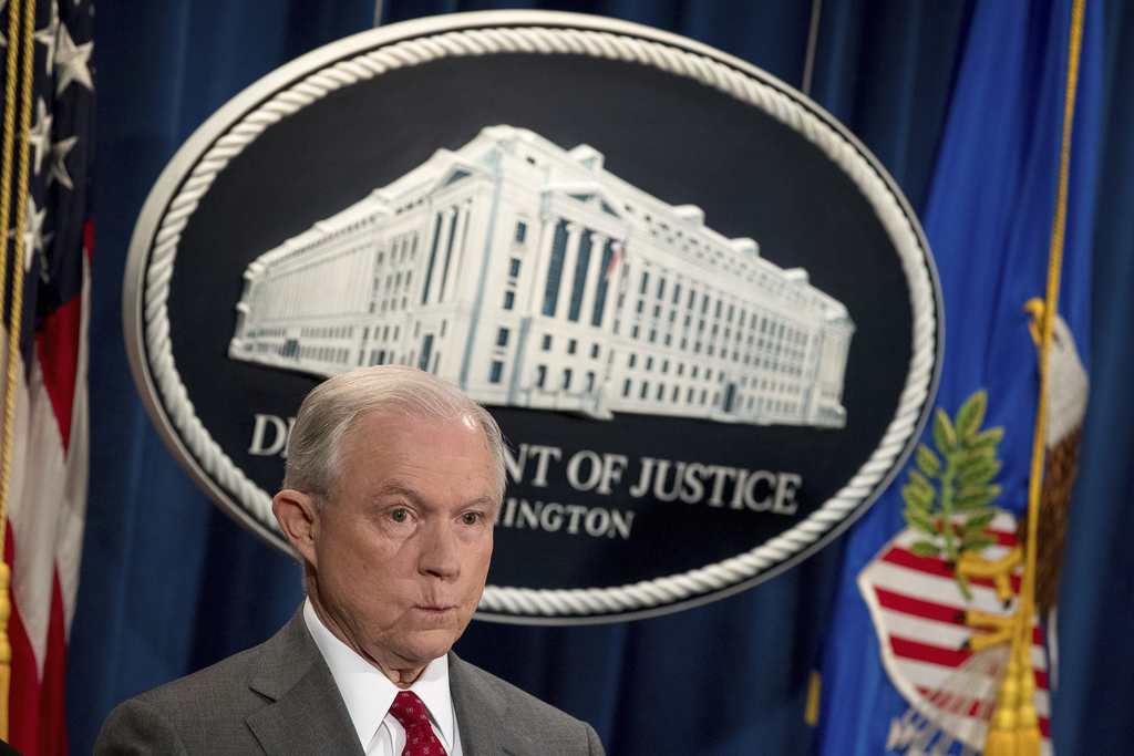 Attorney General Jeff Sessions attends a news conference at the Justice Department in Washington, Friday, Aug. 4, 2017.  Sessions has warned of a crac...