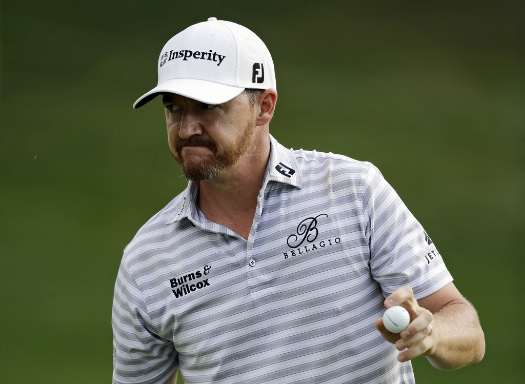 Jimmy Walker acknowledges the gallery after finishing the second round of the Bridgestone Invitational golf tournament at Firestone Country Club, Frid...