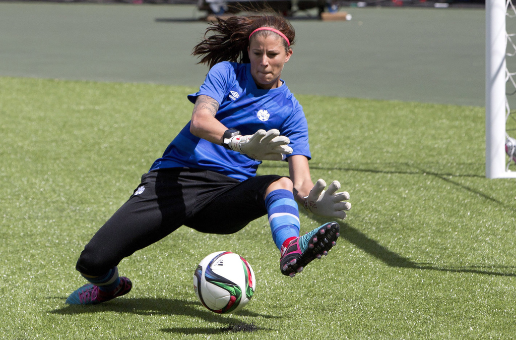 FILE - In this June 5, 2015, file photo, Canada's goalkeeper goalkeeper Stephanie Labbe makes a save during soccer practice in Edmonton, Alberta. Labb...