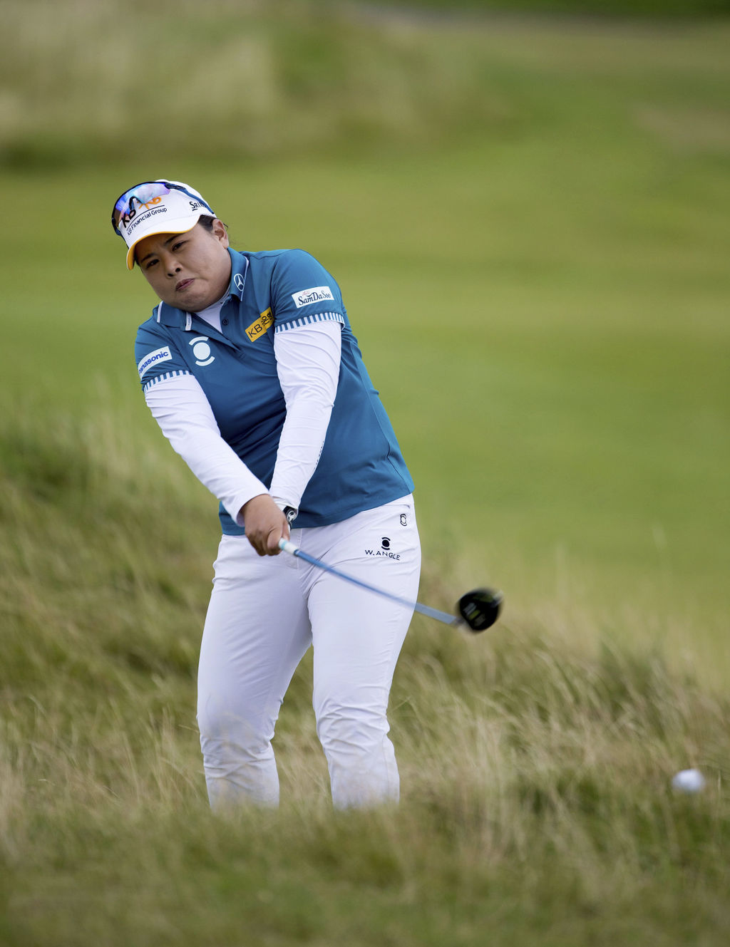 South Korea's Inbee Park plays from the rough at the 15th hole dduring day three of the Women's British Open at Kingsbarns Golf Links, St Andrews, Sco...