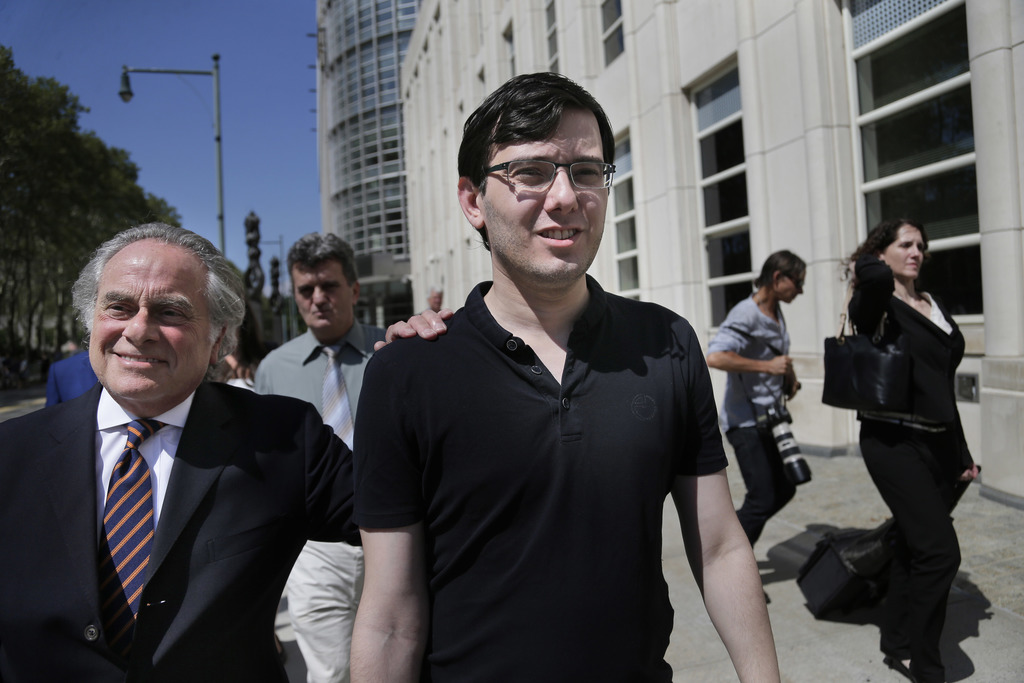 Martin Shkreli, center, leaves federal court in New York, Friday, Aug. 4, 2017. Shkreli, the eccentric former pharmaceutical CEO notorious for a price...