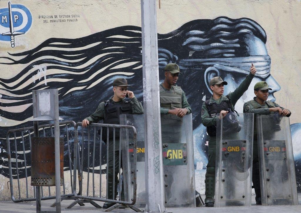 Venezuelan Bolivarian National Guards officers lineup outside of General Prosecutor headquarters in Caracas, Venezuela, Saturday, Aug. 5, 2017. Securi...