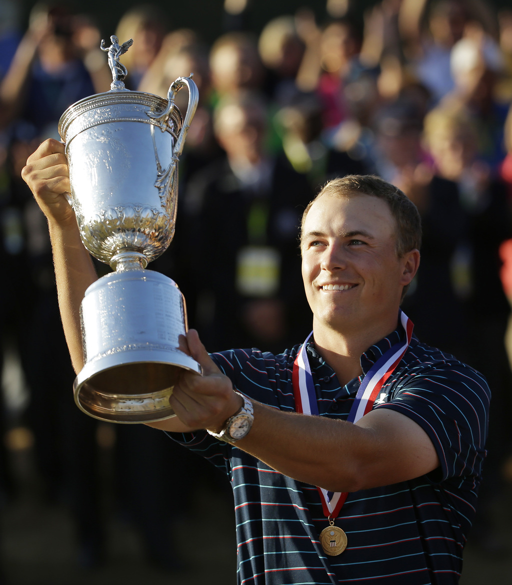 FILE - In this June 21, 2015, file photo, Jordan Spieth holds up the trophy after winning the U.S. Open golf tournament at Chambers Bay in University ...