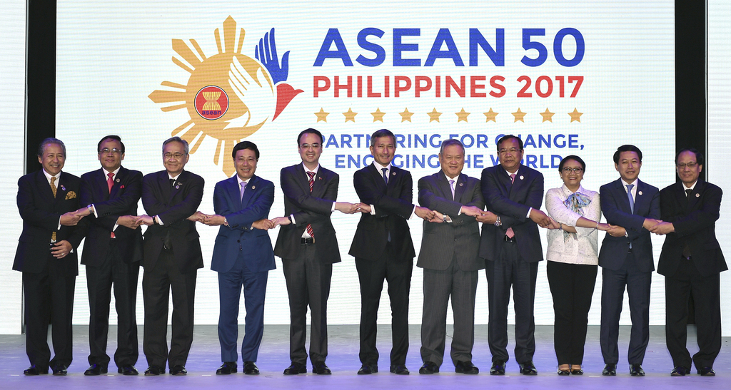 """In this Saturday, Aug. 5, 2017, file photo, ASEAN Foreign Ministers link hands """"The ASEAN Way"""" at the opening ceremony of the 50th ASEAN Foreign Minis..."""