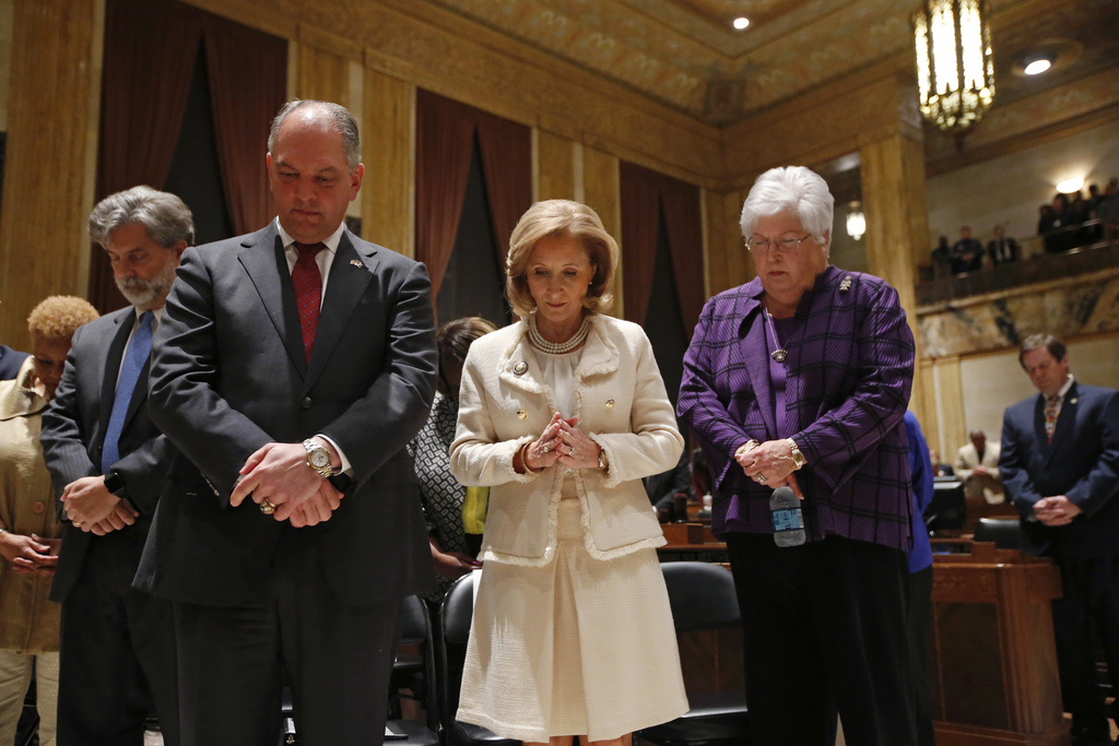 FILE - In this Monday, Feb. 13, 2017 file photo, Gov. John Bel Edwards, foreground left, bows his head for the invocation, with his wife Donna Edwards...