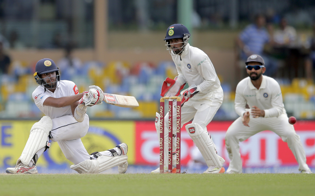 Sri Lanka's Kusal Mendis, left, plays a shot during their second cricket test match against India in Colombo, Sri Lanka, Saturday, Aug. 5, 2017. (AP P...