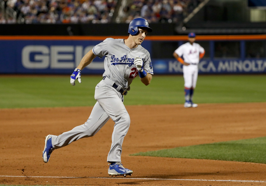 Los Angeles Dodgers' Chase Utley rounds the bases after hitting a two-run home run against the New York Mets during the sixth inning of a baseball gam...