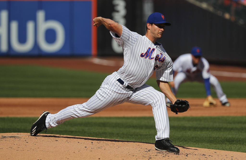 New York Mets relief pitcher Seth Lugo (67) delivers against the Los Angeles Dodgers during the second inning of a baseball game, Saturday, Aug. 5, 20...