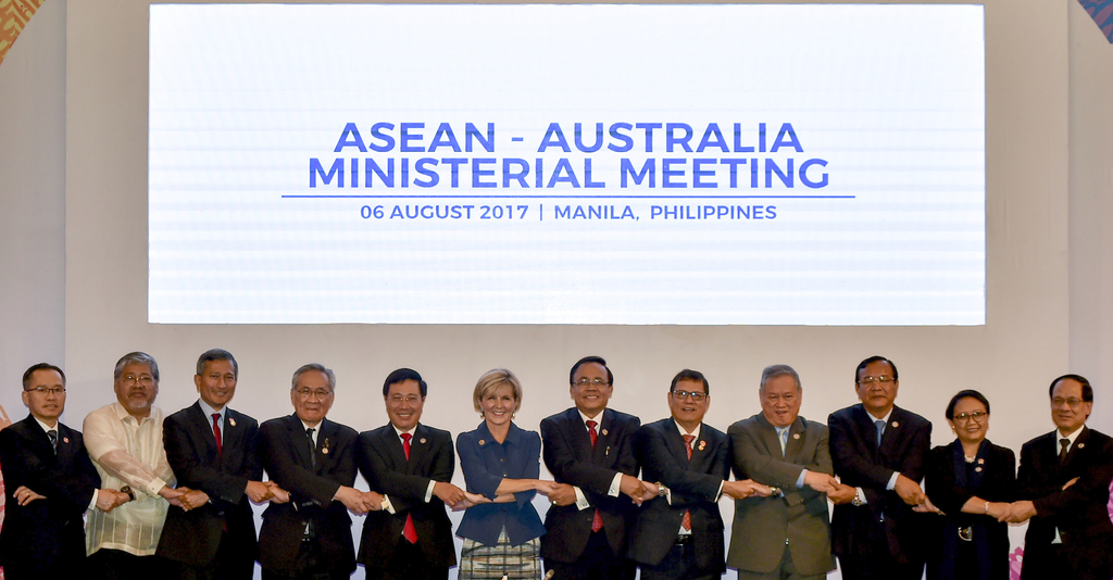 Australia's Foreign Minister Julie Bishop, sixth from left, links arms with the Association of Southeast Asian Nations foreign ministers during the AS...