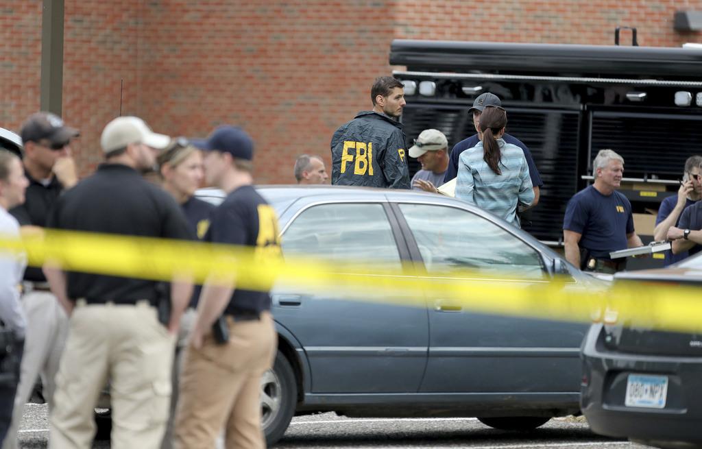 Law enforcement officials investigate an explosion at the Dar Al-Farooq Islamic Center in Bloomington, Minn., on Saturday, Aug. 5, 2017.   Bloomington...