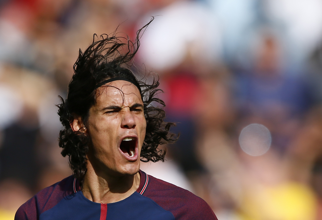 PSG's Edinson Cavani celebrates after scoring a goal during the French major soccer league opening match between Paris Saint-Germain and Amiens at the...