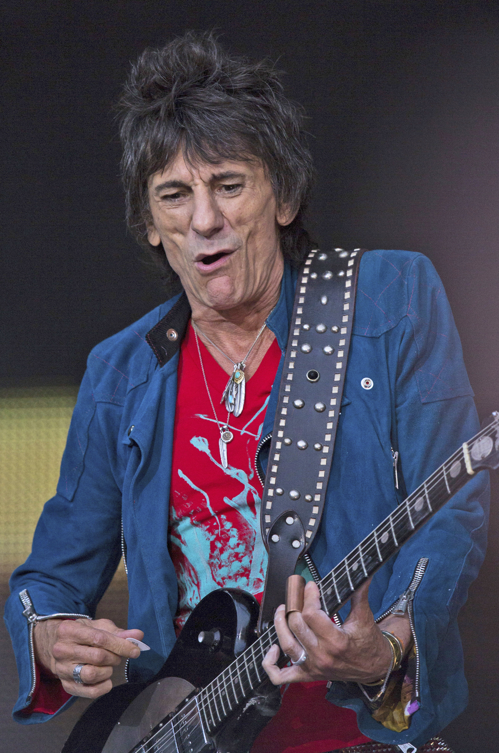 FILE - In this file photo dated Tuesday, June 10, 2014, British rock band Rolling Stones guitarist Ronnie Wood performs during a concert in Berlin.  I...
