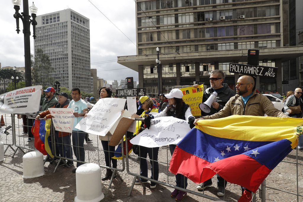 Venezuelan citizens living in Brazil protest against Venezuelan President Nicolas Maduro, outside Sao Paulo's City Hall as the Foreign Ministers of Me...