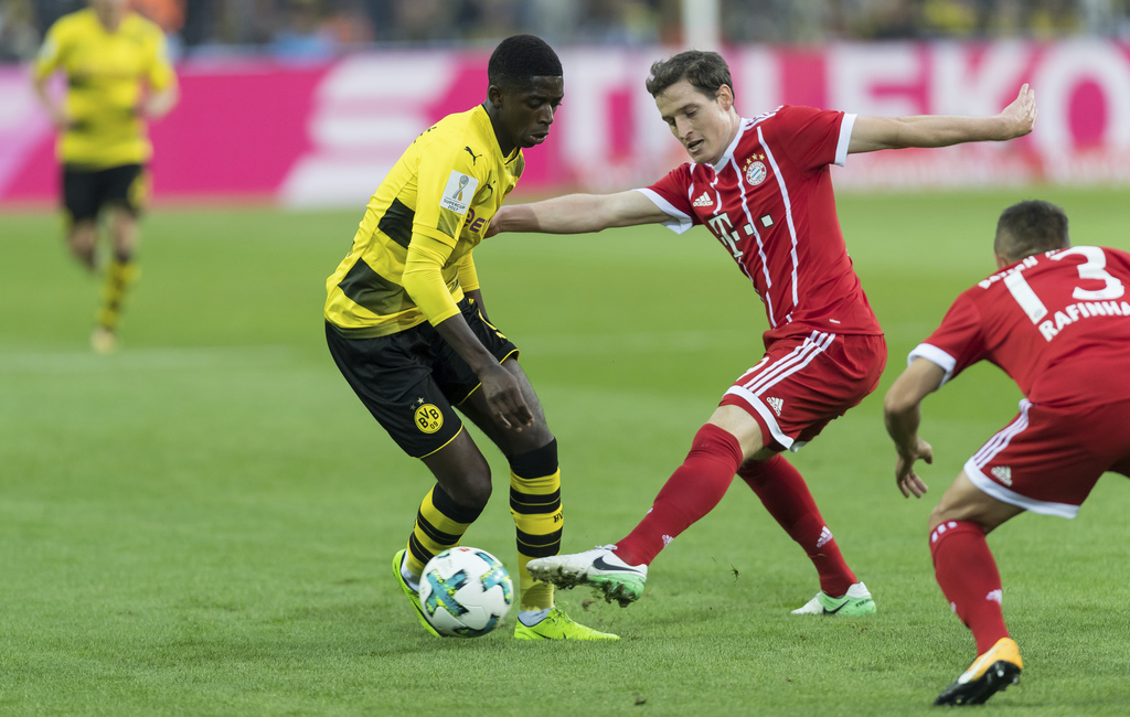 Dortmund's Ousmane Dembele, left, and Bayern's Sebastian Rudy vie for the ball during the Supercup soccer final between FC Bayern Munich and Borussia ...