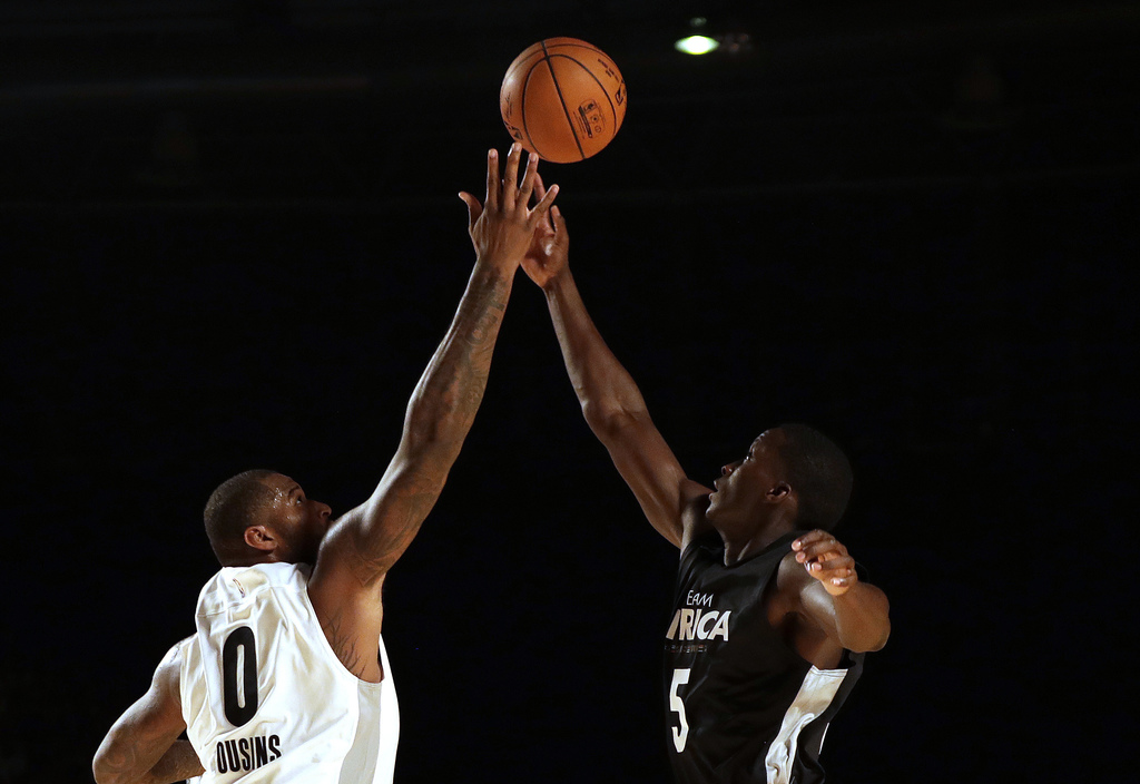 Team World's DeMarcus Cousin of New Orleans Pelicans, right, defends against Team Africa's Victor Oladipo of Indiana Pacers, during the NBA Africa Gam...