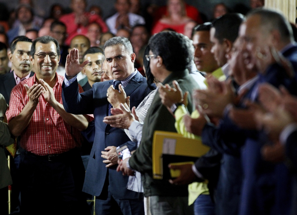 In this Saturday, Aug. 5, 2017 photo, Venezuela's ombudsman Tarek William Saab, center, is congratulated by members of Constitutional Assembly after h...