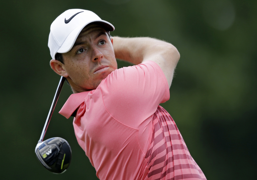 Rory McIlroy, from Northern Ireland, tees off on the third hole during the third round of the Bridgestone Invitational golf tournament at Firestone Co...
