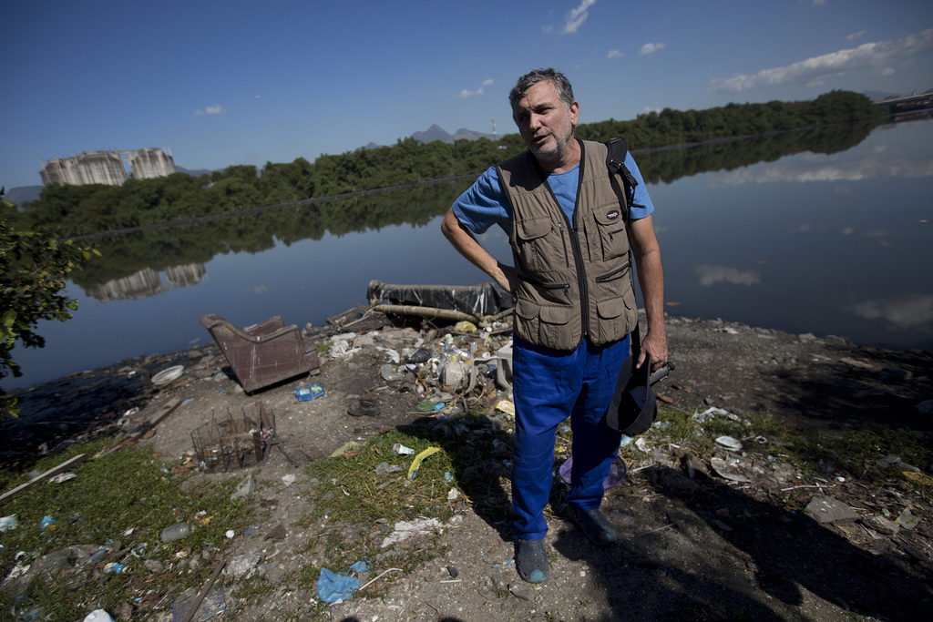 In this  July 31, 2017 photo Biologist Mario Moscatelli speaks during an interview with the AP on the shores of Guanabara bay, in Rio de Janeiro, Braz...
