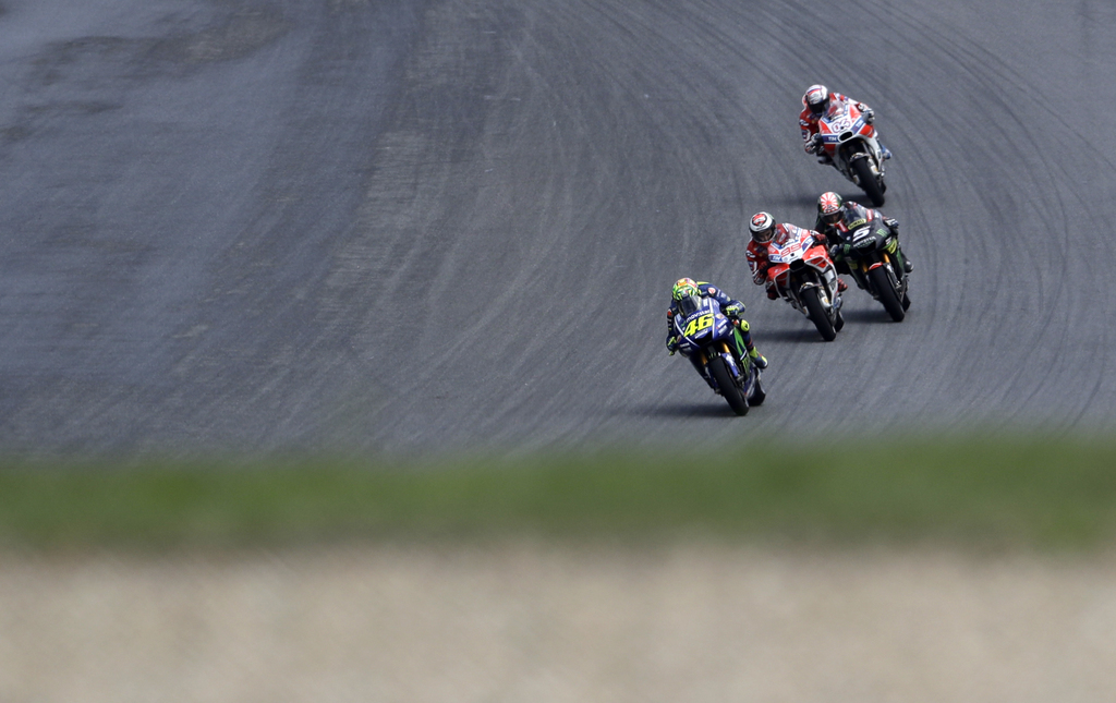 Italian MotoGP rider Valentino Rossi of the Movistar Yamaha MotoGP team leads a pack of riders during the MotoGP race at the Czech Republic motorcycle...