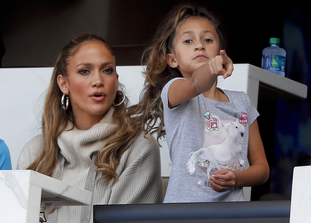 Jennifer Lopez, left, and her daughter Emme Maribel Muniz watch a baseball game between the New York Mets and the Los Angeles Dodgers, Saturday, Aug. ...