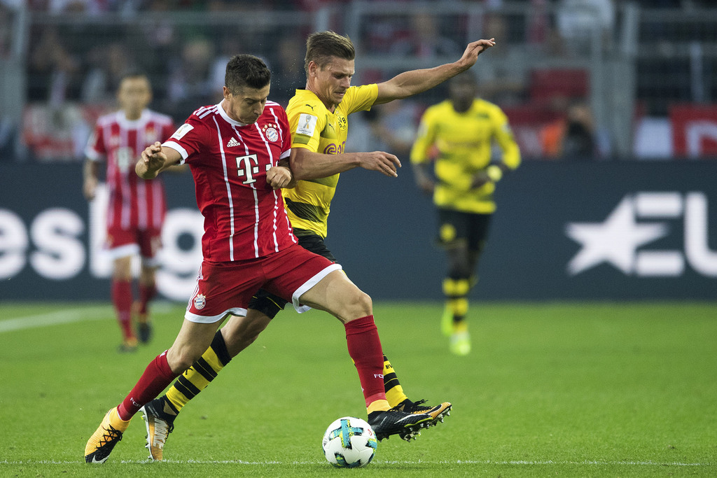 Dortmund's Lukasz Piszczek, right, and Bayern's Robert Lewandowski vie for the ball  during the Supercup soccer final between FC Bayern Munich and Bor...