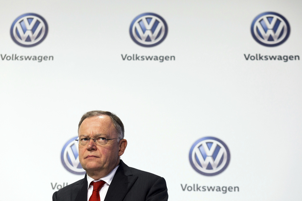 File - In this Nov. 18, 2016 file photo Lower Saxony governor Stephan Weil sits in front of a wall with Volkswagen logos in Wolfsburg, Germany. Weil s...