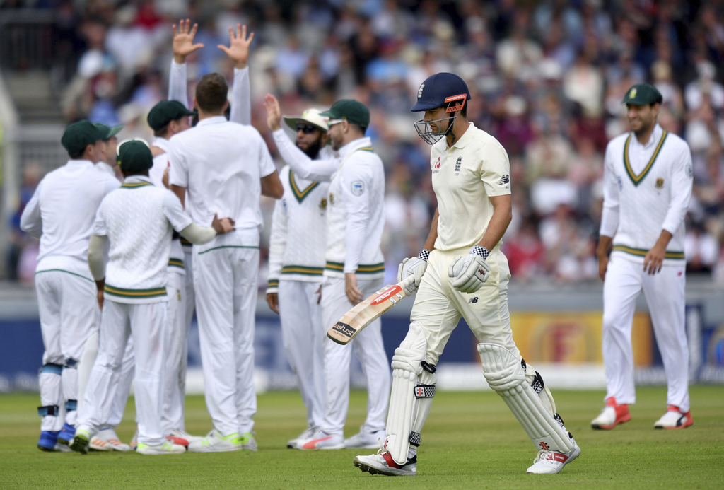 South Africa's Morne Morkel celebrates with teammates after taking the wicket of England's Alastair Cook, centre, during day three of the Fourth Test ...