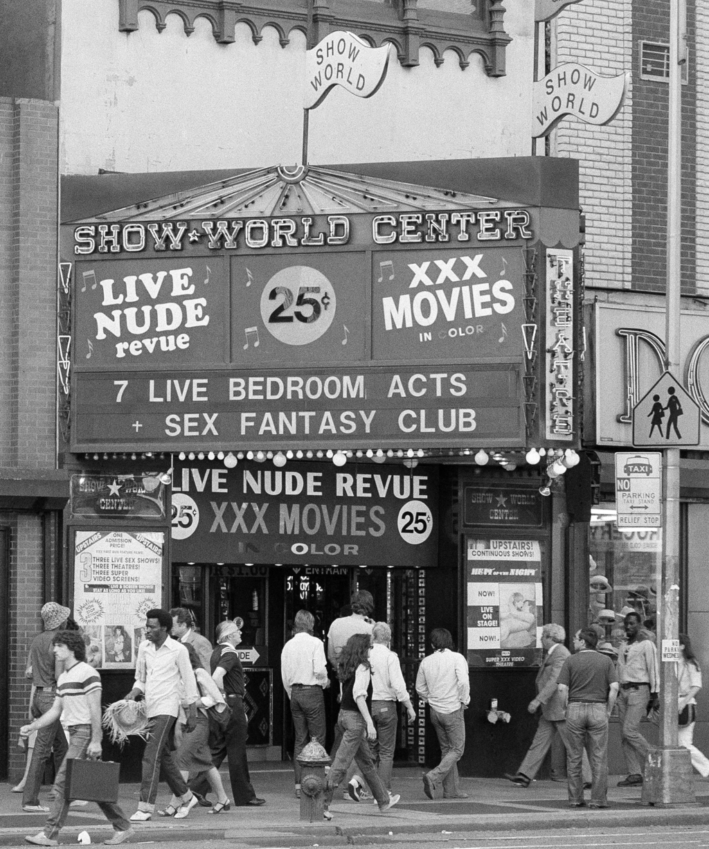FILE - In this Aug. 9, 1979, file photo, people walk past Show World Center at the edge of New York's Times Square. New York City's two-decade legal w...