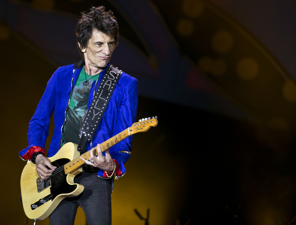 FILE - In this file photo dated Friday March 25, 2016, Rolling Stones guitarist Ron Wood performs during a Rolling Stones concert in Havana, Cuba.  In...