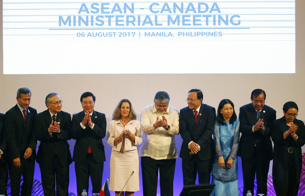 Canadian Foreign Minister Chrystia Freeland, fourth left, applauds with the Association of Southeast Asian Nations foreign ministers and their represe...