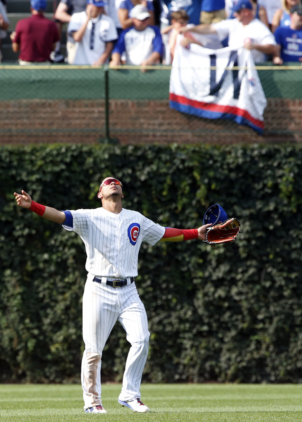 Chicago Cubs' Wilson Contreras celebrates after the Cubs defeated the Washington Nationals 7-4 in a baseball game Saturday, Aug. 5, 2017, in Chicago. ...