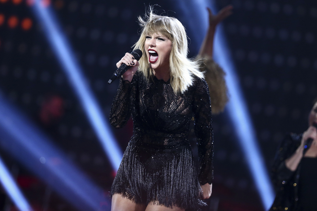 FILE - In this Feb. 4, 2017 file photo, Taylor Swift performs at the DIRECTV NOW Super Saturday Night Concert in Houston, Texas. Swift isn't nominated...