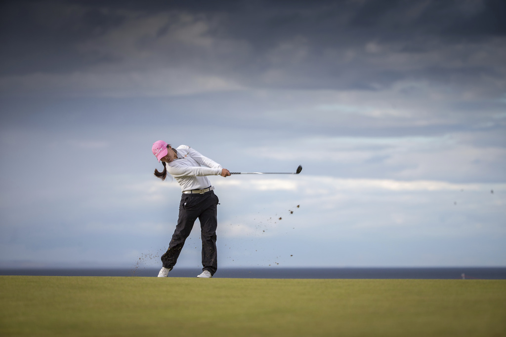 Korea's In-Kyung Kim plays her approach to the 17th hole during day three of the Women's British Open at Kingsbarns Golf Links, St Andrews, Scotland, ...