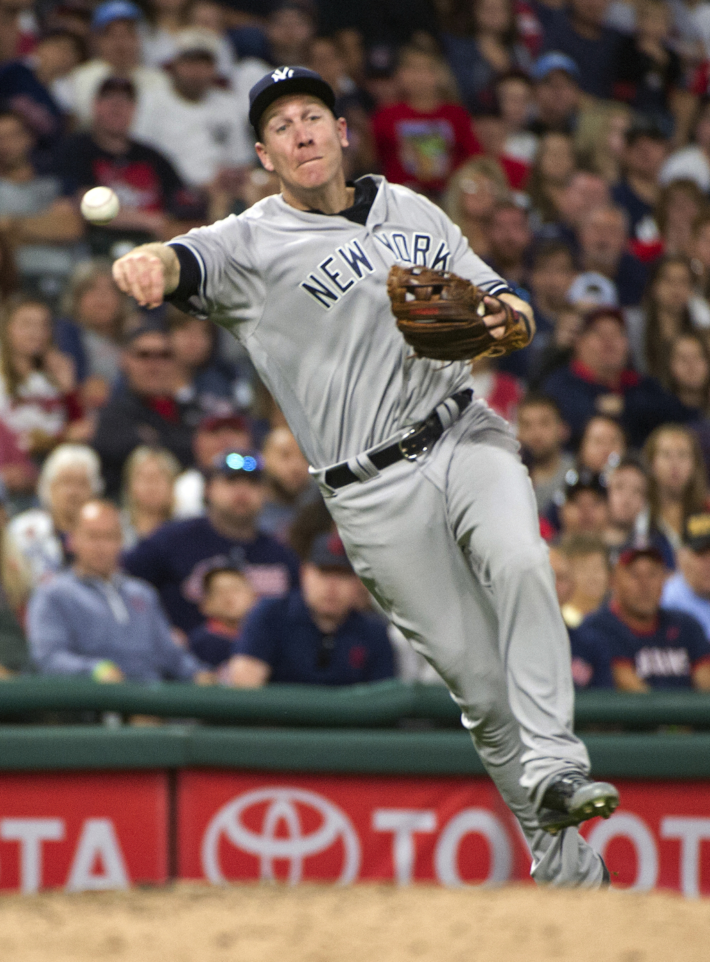 New York Yankees' Todd Frazier throws out Cleveland Indians' Yan Gomes at first base to end the seventh inning of a baseball game in Cleveland, Saturd...