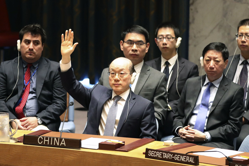 RETRANSMISSION TO CORRECT SPELLING TO LIU JIEYI - Chinese Ambassador to the United Nations Liu Jieyi votes during a Security Council meeting on a new ...