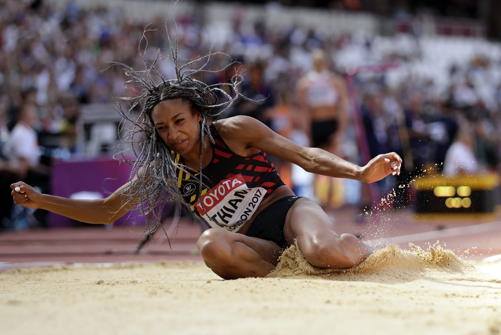 Belgium's Nafissatou Thiam makes an attempt in the long jump of the heptathlon during the World Athletics Championships in London Sunday, Aug. 6, 2017...