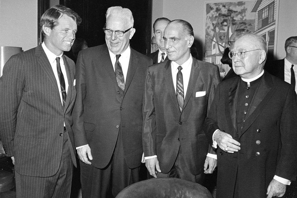 FILE - In this April 4, 1967, file photo, U.S. Sen. Robert F. Kennedy, from left, Chief Justice Earl Warren of the U.S. Supreme Court, Assembly Speake...