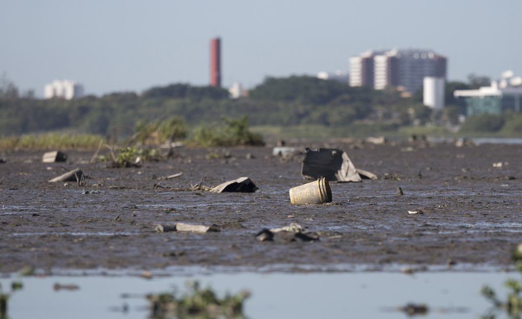 This July 31, 2017 photo, shows the heavily the polluted Jacarepagua lagoon, in Rio de Janeiro, Brazil. Rio pledged in its Olympic bid to treat 80 per...