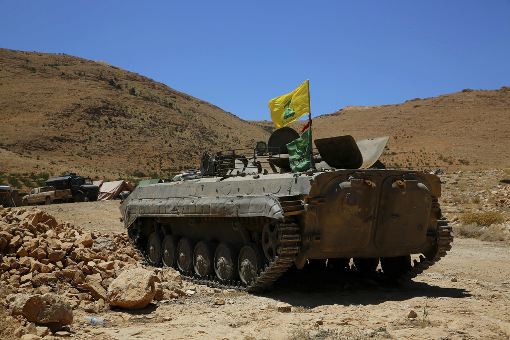 FILE - a Hezbollah armored vehicle sits at the site where clashes erupted between Hezbollah and al-Qaida-linked fighters in Wadi al-Kheil or al-Kheil ...