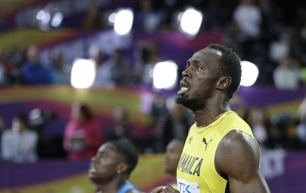 Jamaica's bronze medal winner Usain Bolt checks his time when crossing the line of the men's 100m final during the World Athletics Championships in Lo...