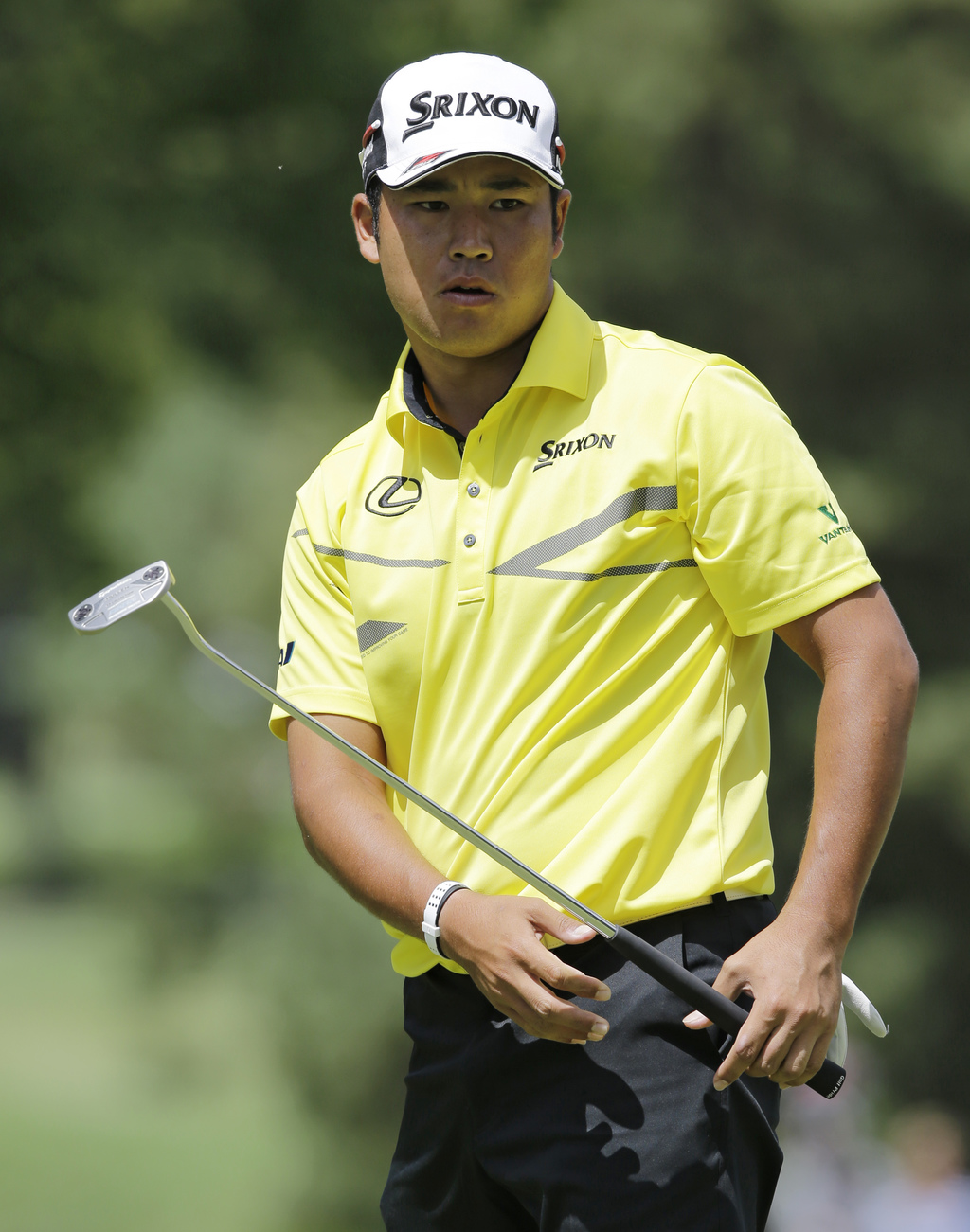 Hideki Matsuyama, from Japan, watches his putt on the second green during the third round of the Bridgestone Invitational golf tournament at Firestone...
