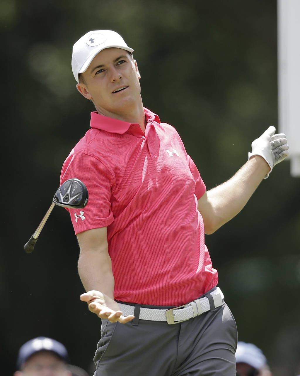 Jordan Spieth drops his club after teeing off off on the third hole during the third round of the Bridgestone Invitational golf tournament at Fireston...