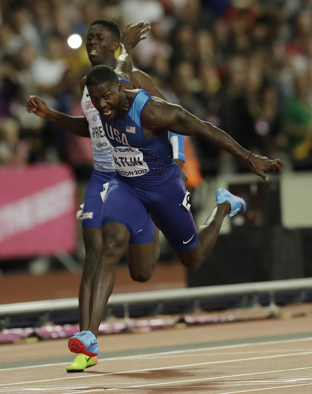 United States' Justin Gatlin crosses the line to win the gold medal in the Men's 100m final during the World Athletics Championships in London, Saturd...