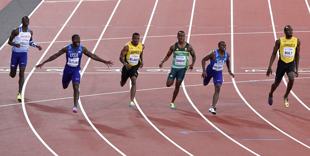 United States' Justin Gatlin, second left, celebrates as he wins the Men's 100 meters final during the World Athletics Championships in London Saturda...