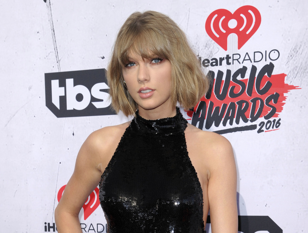FILE - In this April 3, 2016 file photo, Taylor Swift arrives at the iHeartRadio Music Awards in Inglewood, Calif. The trial of a lawsuit between Swif...