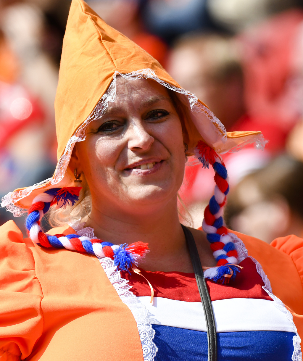 A Dutch soccer fan smiles at the stadium prior to the Women's Euro 2017 final soccer match between Netherlands and Denmark in Enschede, the Netherland...